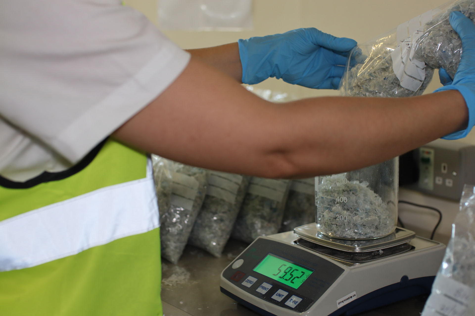 Recycled plastic being weighed