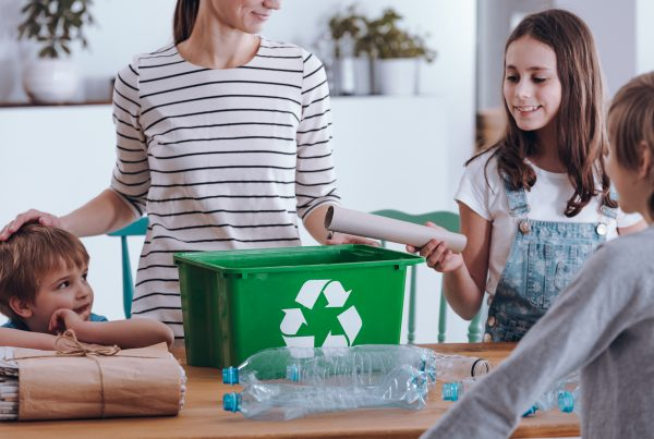 Family learning to recycle