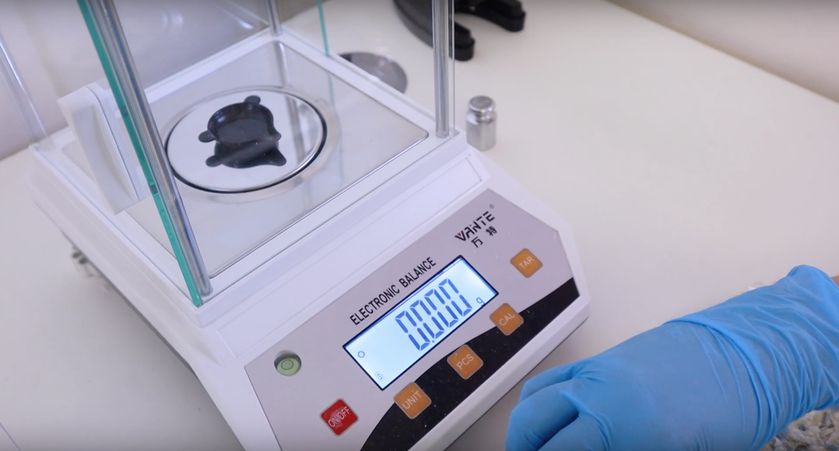 Person working with scales in lab